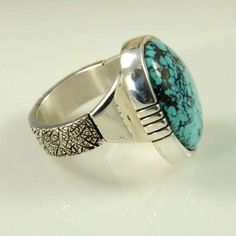 Nevada Blue Turquoise Ring by Craig Agoodie. Navajo silversmith, Craig Agoodie designed and made this contemporary heavy sterling silver ring which is set with a 20ct Natural Nevada Blue Turquoise stone.