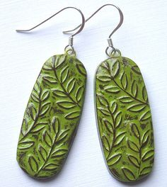 BlockPartyPress @ Etsy - polymer clay earrings - brown clay with lime green paint. love the look!