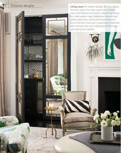 Inspiration for a hidden kitchen from Lonny Magazine. Simple DIY molding over mirrors?