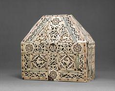 Bursa Reliquary   Date: 10th century  Culture: North Italian  Medium: Bone, copper-gilt, wood  Dimensions: Overall: 7 3/4 x 7 5/16 x 3 1/4in. (19.7 x 18.6 x 8.3cm)  Classification: Ivories