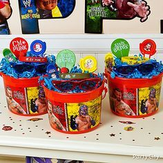 """Win the title of """"best party ever"""" by sending each kid home with a WWE favor container brimming with goodies like skateboard key chains, sunglasses, paddleballs and more!"""