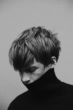 freckles and black polo neck