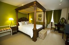 The Osbourne Room with beautiful four poster bed and carved window detail downstairs in Paddy's Way at Ballyseede Castle Stay In A Castle, Castle Rooms, Four Poster Bed, Luxury Rooms, Luxury Accommodation, Fine Dining, Family Room, Relax, Window Detail