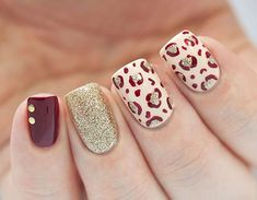 Red, white and gold winter nail art design. Fill your nails with a variety of designs such as animal prints and glitter nail art to make it stand out from the rest. You can also add golden beads on top for accent. Previous Post Next Post Cheetah Nail Designs, Leopard Print Nails, Nail Art Designs, Nails Design, Leopard Prints, Red Cheetah Nails, Maroon Nail Designs, Burgundy Nails, Fall Nail Art