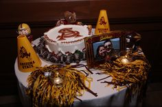 Joint/Groom's Cake- We met at ASU and he loves football.  So we incorporated football theme and added chocolate covered strawberry footballs.  | Image by Classic Digital Photography®, LLC, Gilbert, Arizona