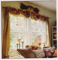 Maybe not the burlap or the the fall colors but I love the way the curtains are hung! It would look really good with a sheer curtain behind it.