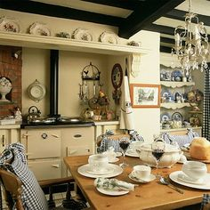 charming cream coloured kitchen.  Lose the chandelier and it's perfect!