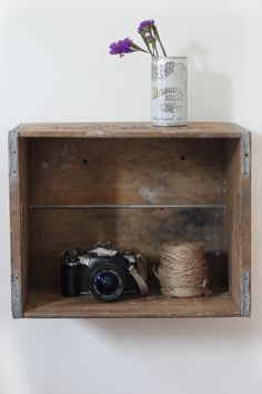 Do It Yourself: Bedroom Crate Shelf. Just need a crate, nails, and a hammer. Simple.