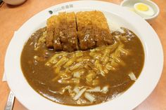 Chicken katsu kare (curry) from CoCo Ichibanya. Try it with cheese and a boiled egg