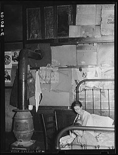 Wife and two children of coal miner. She is sick, has five other children. Marine, West Virginia. Wolcott, Marion Post, 1910-1990, photographer. 1938 Sept.