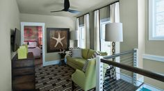 "Living room wall color ""Khaki Shade"" by Sherwin Williams - HGTV Smart Home 2013 Loft"