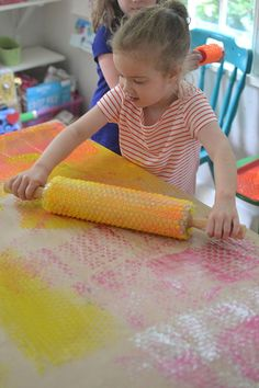 kids use their whole body when printing with bubble wrap and rollers