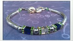 Inspired by the Seattle Seahawks crystal by getyourjewlzon on Etsy, $22.00