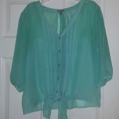 Turquoise blouse Sheer Turquoise color Has been worn couple times  awesome condition V-neck front Charlotte Russe Tops Blouses