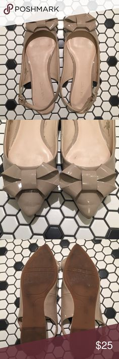 Nude Bow Flats Used a few times but still great condition. There is a scuff on the bottom left bow (tried magic eraser but it didn't work) but you can't see it when wearing. Adjustable back straps. Love but sat in my closet untouched for too long so time to sell. Patent leather. Happy to answer questions. Bundle to save! Nine West Shoes Flats & Loafers