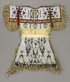 A SIOUX GIRL'S BEADED HIDE DRESS. c. 1880...