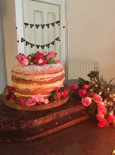 Naked hand decorated Victoria sponge cake