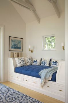 Built-ins, like this bed, take up a smaller footprint than freestanding pieces of furniture. And because the furniture is part of the surrounding architecture, it takes up less visual space as well. Plus, you can get the benefit of extra storage.