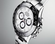 Rolex Cosmograph Daytona Watch uses high technology to return this classic timepiece to its roots. The bezel is made from black ceramic with a super-thin layer of platinum to help the numerals standout, resulting in a look reminiscent of the black plexiglas bezel of the 1965 model. To match the new bezel, the white dial version gets black rings around the subdials, while the black dial gets contrasting silver rings. $12,000