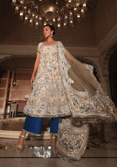 Our eclectic Kashmiri Kalidar embroidered in scalloped floral artwork and bright sequins paired with electric blue palazzos is your sartorial chic summer statement.   Manish Malhotra Manish Malhotra, Floral Artwork, Electric Blue, Cloths, Sequins, Pairs, Bright, Chic, Summer