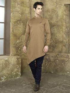 Shop Khaki colored kurta suit online from India. Mens Indian Wear, Indian Men Fashion, Mens Fashion Wear, Kurta Pajama Men, Kurta Men, Pathani For Men, Pathani Kurta, Boys Kurta Design, Mens Suits Online