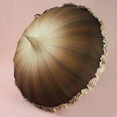 Latte brown fades down to espresso bean brown with a matching ruffle trim bella umbrella