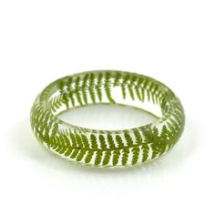 Nature inspired pressed & dried fern leaves in transparent resin modern bangle bracelet  + Small size internal diameter 6cm - 2.36 + Medium size internal diameter 6.2cm - 2.44  + Height: 2cm - 0.79 + Thickness: 1cm - 0.39  + lightweight and comfortable to wear  This bangle has been entirely handmade by moi in France. One of a kind. You will not receive exactly the same from the one in pictures but it will be of equal quality.  This piece comes in its jewelry box or cotton pouch and gift w...