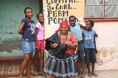 A Tsonga family seen outside a hair salon during a walking tour