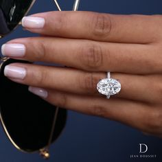 a762bbccb CHELSEA, platinum engagement ring set with a 5 carat oval diamond,  exclusively by Jean