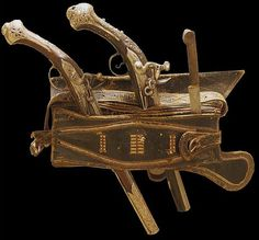 Ottoman leather weapons belt (selahlik / silahlik) worn throughout the Ottoman Empire, made from layers of leather containing slips to hold a yatagan sword and other weapons. Shown with two flintlock pistols.