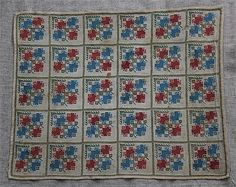 An early 20th century Greek Island cross stitch textile panel, worked with thirty squares each with a matching geometric pattern in blue, red, green and yellow, lightly tack stitched to a later linen backing