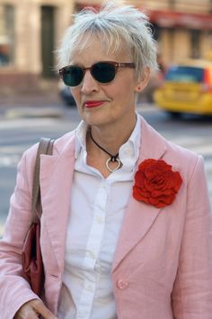 Stylish woman in Stockholm, Sweden. Notice the red stud in her ear. :) Photographer: Ari Seth Cohen
