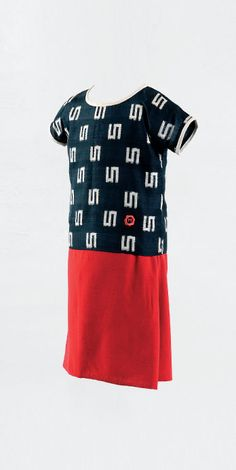 Paul Poiret designed this for his daughter Martine! The 1924 ensemble, comprising tunic and skirt, features a monogram with the letter M for Martine (b. 1911) surrounded by a scalloped cartouche in red silk thread.
