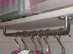 Hang towel rods upside down to use as unexpected hanging storage in the laundry room or a broom closet. Now why didnt I think of this??