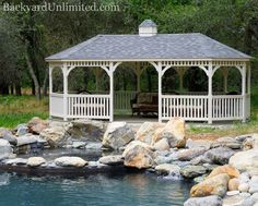 12'x24' Wood Dutch Style Oval Gazebo with Custom Paint and Cupola from Backyard Unlimited--beautiful natural setting with a pool that looks like a pond! http://www.backyardunlimited.com/gazebos.php
