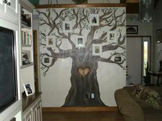 "One day I was bored so I decided to paint a ""family tree"" on My living room wall and hang pix of the kids on the branches."