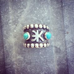 Custom brand ring with turquoise, by Silo Silver. I would love to get a ring with our brand ( -D) on it.