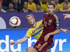 Sweden's Sebastian Larsson fights for the ball with Russia's Viktor Fryzulin during their Euro 2016 qualifying soccer match at Friends Arena in Stockholm