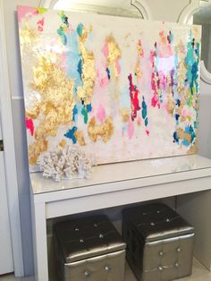 gold leaf, pink, gold, and white painting in white, silver and gray bathroom with chandelier