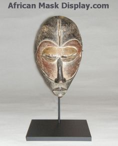 Display stands to hold African masks. www.ArtDisplay.com