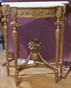Pretty #console #LouisXVI #style in #giltwood. Four fluted legs, and brace decorated with a vase filled with flowers and leaves. Top in white# marble. #19th century. For sale on Proantic by Edith Davidson.