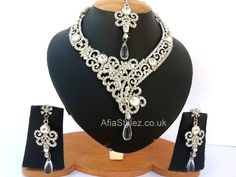 Indian Bridal Necklace set    High quality silver plated rhinestone crystal necklace earrings tikka sets comes in  6 Colors  Unique western and eastern design in one stunning combined set  White Rhinestone crystals all over with second color rhinestone crystals  Exquisite stunning spark looks gorgeous  Fabulous 2013 Latest Bollywood fashion trend  color:  Green – Blue - Purple - Pink - White - Red  http://afiastylez.co.uk/product/indian-bridal-necklace-set-bollywood-rhinestone-crystal/