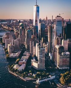 Downtown Manhattan, New York City, New York, USA. The One World Trade Center towering in the background.