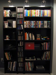 """Ikea's Billy Bookcase    Three shelving units combined into one, from Ikea. Left to right: 16"""" Billy Bookcase, 8"""" Benno CD tower, 32"""" Billy Boockase. Inreda lights on top, also from Ikea."""