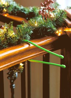 """Twisty """"gear ties"""" are chiefly meant to corral cords — but they also make it easy to hang garland from railings (plus, they look kinda fun to use!). And since they come in a variety of colors, you can choose the one that best matches your railing or garland."""