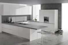 white-clean-kitchen-island-with-grey-solid-surface-countertop-and-slim-bar-stools-above-ceramic-flooring.jpg (958×634)