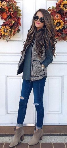 #fall #outfits  women's gray-and-black chevron jacket, distressed blue jeans, gray shirt, and gray heeled ankle-high boots outfit