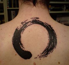 Abstract ouroboros tattoo