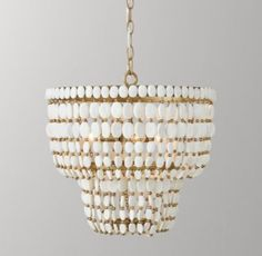 RH Baby & Child's Remi Medium Pendant - White:Strands of alternating wood and metal beads are suspended from a sturdy metal frame in an arrangement that recalls the tiered silhouette of traditional Moroccan pendants.