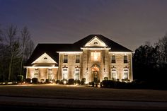 Beautifully balance architectural lighting with custom second level accents by Outdoor Advantage